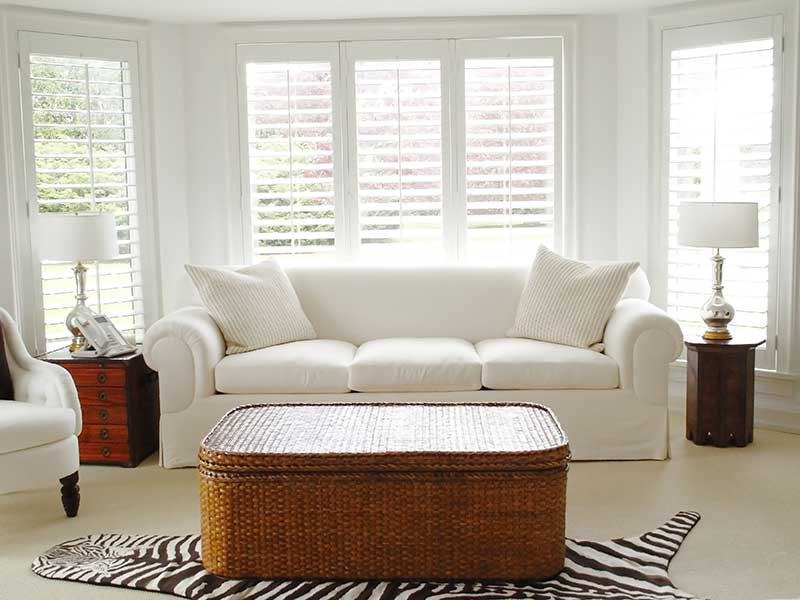 bright lounge with long white shutters at windows