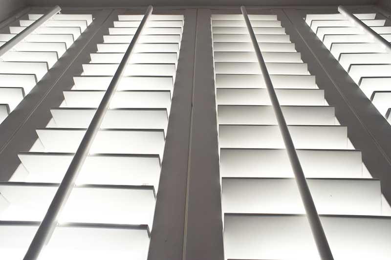 low angle shot of white shutters